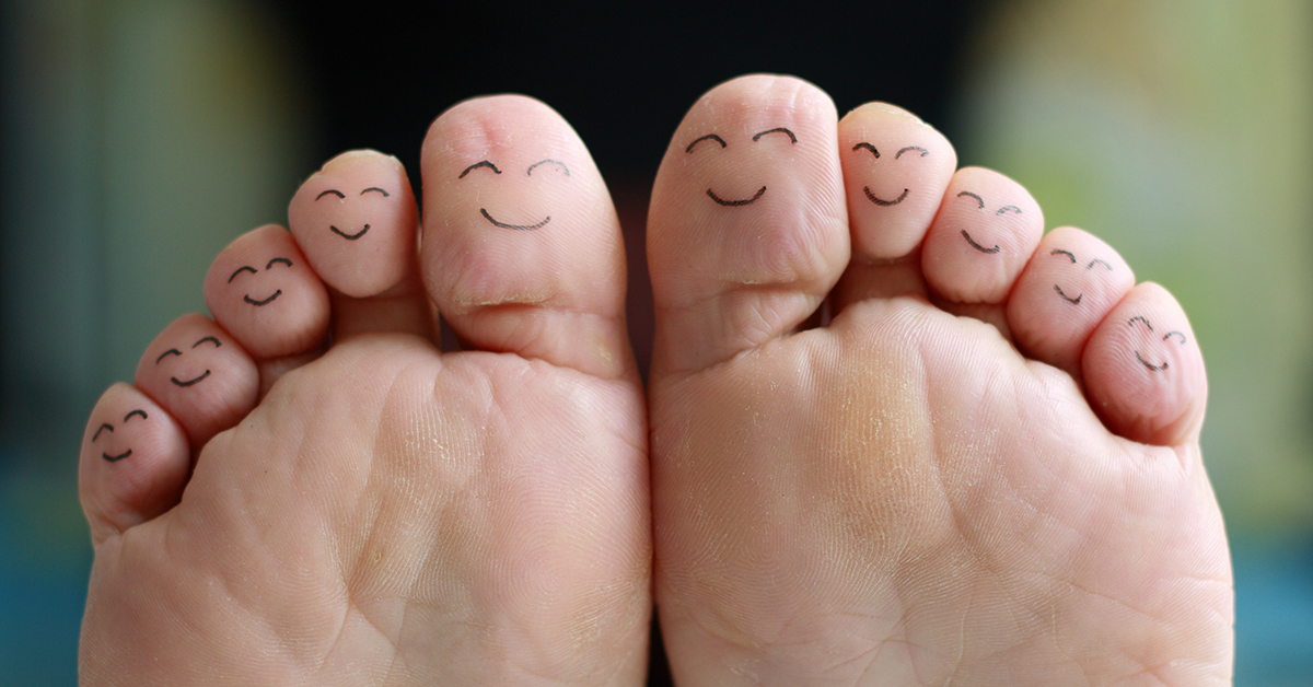 Toes with smiley faces drawn on them