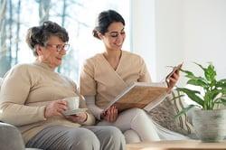 Home care nurse and senior woman