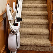 Savaria K2 Stair Lift in closed position at the bottom of staircase