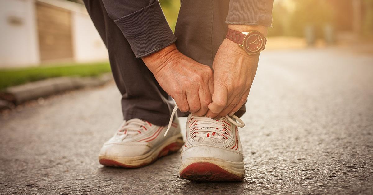 Senior woman tieing shoe lace