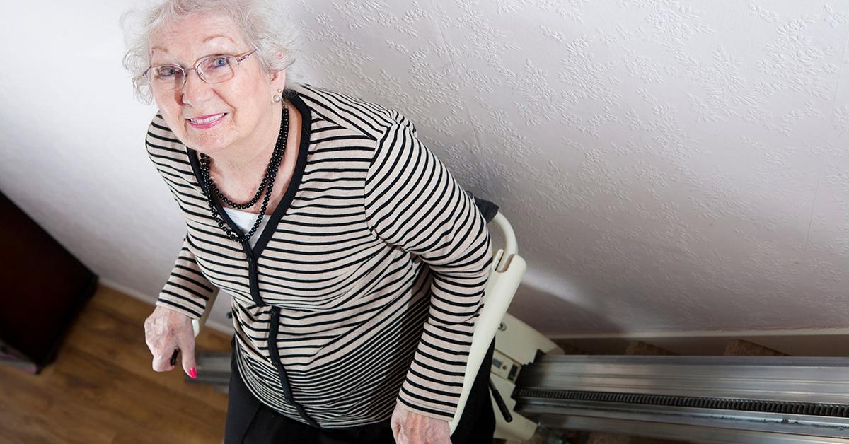 Senior lady on stairlift