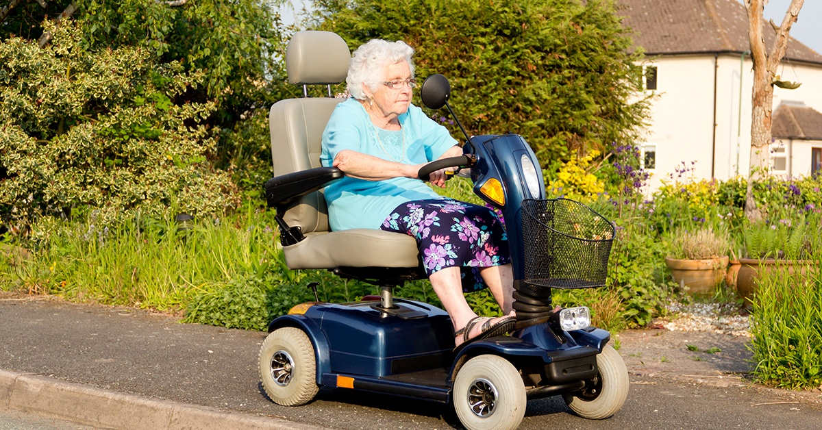 Senior woman on mobility scooter