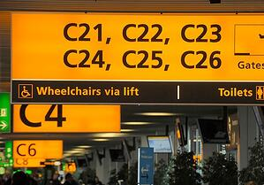 Sign showing wheelchair access to planes in airport