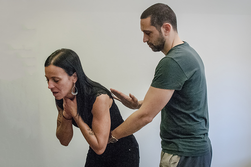 "Man and woman demonstrating the American Red Cross ""five-and-five"" method for choking"